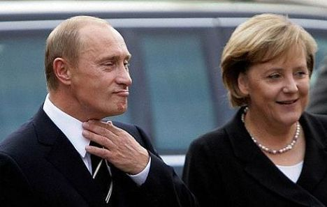 Vladimir Putin,Angela Merkel